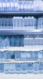 Water bottles on shelf Royalty Free Stock Images