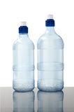 Water bottles on white. Two blank empty water bottles on a white background Stock Photo