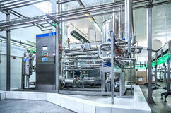 Water bottling plant. Water green bottling plant. Industrial conveyor of mineral water. process equipment Royalty Free Stock Photo