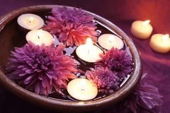 Water Bowl for Aromatherapy with Candles. Water Bowl for Aromatherapy with Burning Candles Evening Time Stock Photos