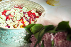 Water in bowl with flowers for Songkran. Water in bowl mixed with perfume and flowers corolla for Songkran festival in Thailand Royalty Free Stock Image