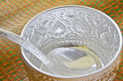 Water bowl made of silver on the mat Royalty Free Stock Images