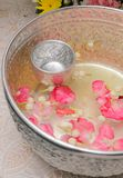 Water in bowl mixed with perfume and flowers corolla Stock Photography
