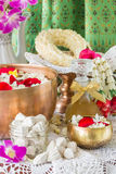 Water in bowl mixed with perfume and flowers. Water in bowl mixed with perfume and flowers, Songkran festival in Thailand stock photo