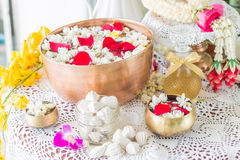 Water in bowl mixed with perfume and flowers. Royalty Free Stock Image