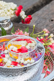 Water in bowl mixed with perfume and flowers. Water in bowl mixed with perfume and flowers, Songkran festival in Thailand stock photos