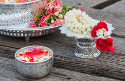 Water in bowl mixed with perfume and flowers. Songkran festival in Thailand royalty free stock photography
