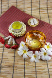 Water in bowl mixed with perfume and vivid flowers. Songkran festival of Thailand Royalty Free Stock Images