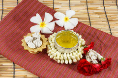Water in bowl mixed with perfume and vivid flowers. Songkran festival of Thailand Stock Photos