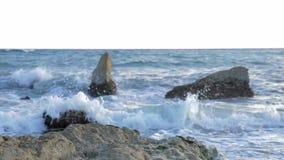 Water breaking in rocks stock video footage