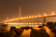 The Water Bridge. The evening, the lights gradually light up on the bridge at the water`s edge Royalty Free Stock Photos