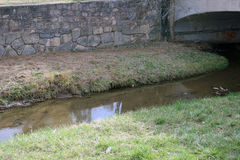 Water and a Bridge. Water flows in the Santa Fe River and under a bridge Stock Images