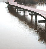 Bridge on water. Walking on water Royalty Free Stock Photography