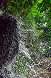 Water is broken down on a rock. splatter. Of water, Fast shutter speed Royalty Free Stock Image