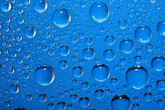 Water bubbles on blue Stock Photos