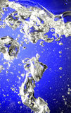 Water and bubbles on blue background. Water and bubbles and drops on blue background royalty free stock photo