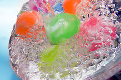 Water bubbles with colorful beads Stock Photos