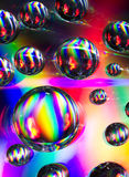 Water bubbles on compact disc surface. Abstract composition created by diffracting light on the wet surface of a compact disc Royalty Free Stock Images