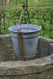 Water bucket. Fountain with a water bucket stock photo