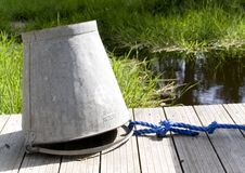 Water bucket on the bridge Royalty Free Stock Photo