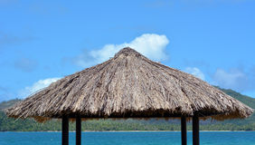 Water bungalow straw roof tropical island background Royalty Free Stock Photos