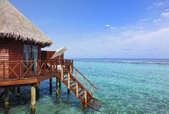 Water bungalow on tropical island Stock Photo