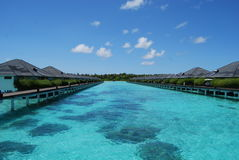 Water bungalows. In Maldives at sunny day stock photography