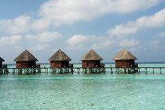 Water bungalows. In a lagoon at a resort in the Maldives stock photography