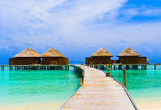 Water bungalows. At a tropical island - travel background Stock Images