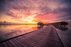 Water bungalows with beautiful blue sky and sea in Maldives Royalty Free Stock Images