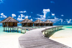 Water bungalows with beautiful blue sky and sea in Maldives Stock Photography
