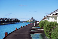 Water bungalows and blue ocean and sunny sky. In Maldices royalty free stock photos