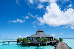 Water bungalows and blue ocean and sunny sky. In Maldices stock photo