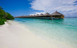 Water bungalows close to the shore Stock Images