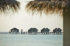Water bungalows in hotel on Maldives. Villas on Indian ocean at luxury spa resort. Water bungalows in hotel on Maldives. Villas on Indian ocean at spa resort Royalty Free Stock Photo