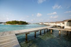 Water bungalows in hotel on Maldives. Villas on Indian ocean at luxury spa resort. Water bungalows in hotel on Maldives. Villas on Indian ocean at spa resort Stock Photo
