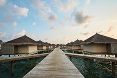 Water bungalows in hotel on Maldives. Villas on Indian ocean at luxury spa resort. Water bungalows in hotel on Maldives. Villas on Indian ocean at spa resort Royalty Free Stock Image