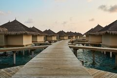 Water bungalows in hotel on Maldives. Villas on Indian ocean at luxury spa resort. Water bungalows in hotel on Maldives. Villas on Indian ocean at spa resort Stock Images