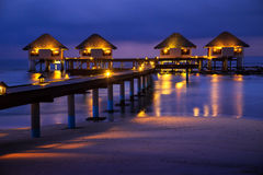 Water bungalows houses at night, tropical landscape Royalty Free Stock Photos