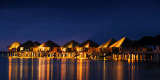 Water bungalows houses at sunset, tropical landscape Royalty Free Stock Photo