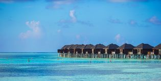 Water bungalows on ideal perfect tropical island Stock Photography