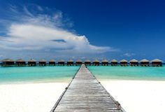 Water bungalows. Jetty to water bungalows on the maldives stock image
