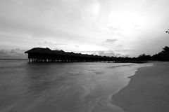 Water bungalows in Maldives in black and white photo. Royalty Free Stock Image