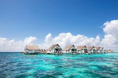 Water bungalows. At Maldives on sunshine day royalty free stock image