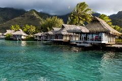 Water-bungalows in Moorea, French Polynesia. Beautiful water invites the visitors of the water-bungalows to snorcel, swim and other water activities stock photos