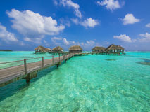 Water bungalows in paradise. Water bungalows at a tropical island - travel background Stock Image