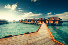 Water bungalows resort at islands Royalty Free Stock Photos