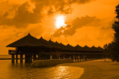 Water bungalows and sunset Royalty Free Stock Image