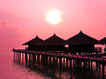 Water bungalows and sunset Royalty Free Stock Photo