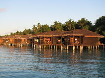 Water bungalows at sunset. Water bungalows - stilt houses - in the Maldives Royalty Free Stock Photo